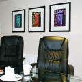 3 framed postboxes on office wall